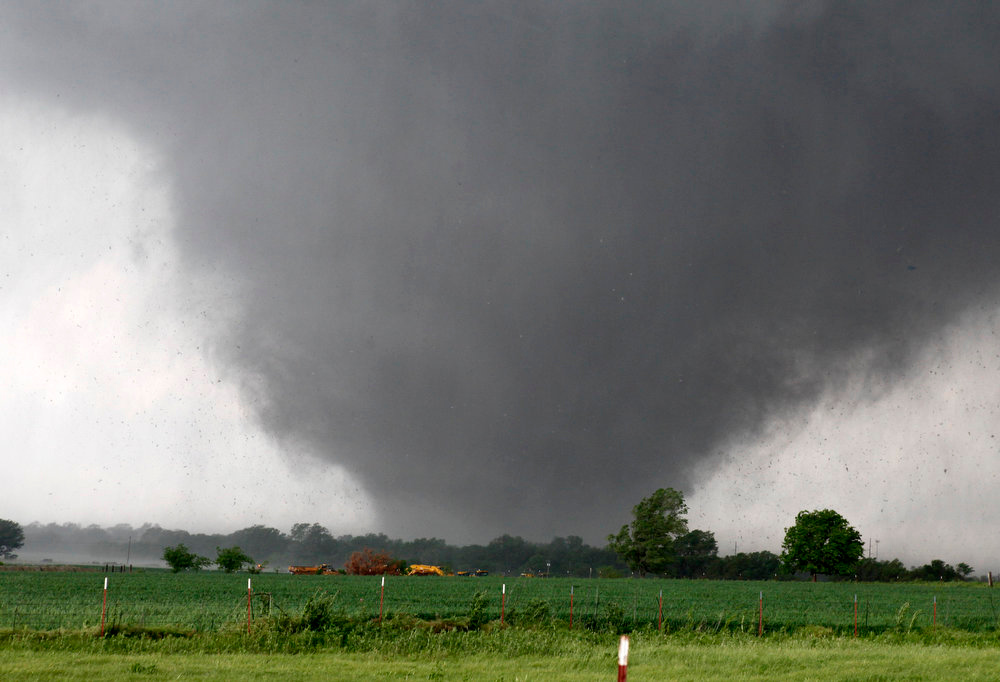 . A tornado passes across south Oklahoma City, Monday, May 20, 2013. A monstrous tornado roared through the Oklahoma City suburbs, flattening entire neighborhoods with winds up to 200 mph, setting buildings on fire and landing a direct blow on an elementary school. (AP Photo/The Oklahoman, Paul Hellstern)