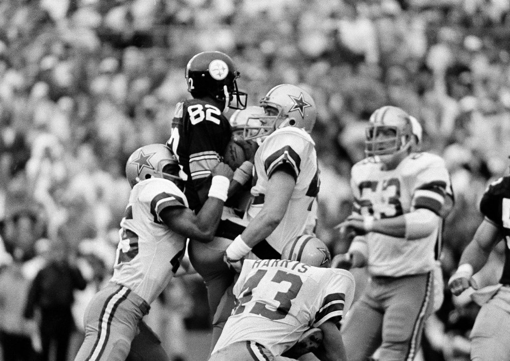 . Pittsburgh Steelers John Stallworth (82) is surrounded by Dallas Cowboys defensemen after reception in half of  Super Bowl game in Miami Sunday, January 21, 1979. Stallworth caught two touchdown passes for the Steelers in the first half. (AP Photo)