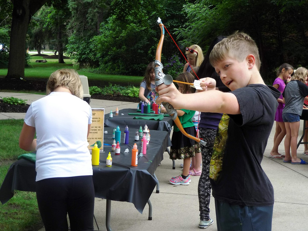 . Ian Cleis sizes up the target during archery practice while at a Zelda-themed program at Mentor Public Library. (Courtesy Mentor Public Library)