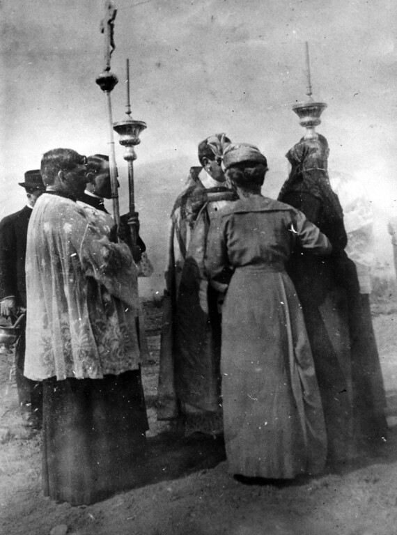 . Circa 1915 - Father John Leal, Father Sousa, Mrs. C.L. Stephens and Abbie Sunderer are seen at the dedication of the Ohlones Cemetery, burial ground for the the mission Indians. The crucifix and processional candle holders were brought from Spain by the founding fathers of the mission in 1797. (Oakland Tribune Staff Archives)