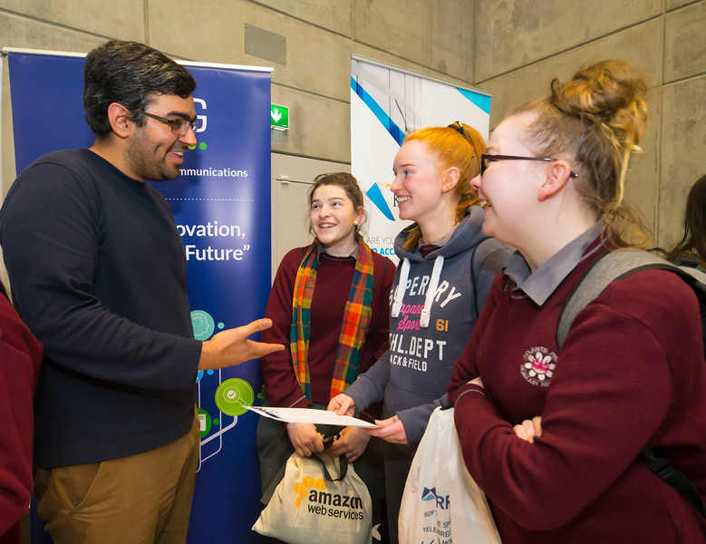 "09/11/2017. Crystal Valley Tech Showcase at WIT Arena. Pictured are Lucy Shahahan, Nicole Power and Cheyanne Kelly from St Declan's Secondary School, Kilmacthomas with Daniel Martins of TSSG. Picture: Patrick Browne  Event demonstrates Tech and ICT is thriving in Waterford and the South East 50 companies and 2,000 students, industry and recruiters attend the inaugural Crystal Valley Tech Showcase event  Over 50 companies who are working together as Crystal Valley Tech showcased their rapidly growing industry in the WIT Arena on Thursday morning to approx. 2,000 members of the public, college and second level students, recruiters, government agencies and other industry.  The future is bright for ICT in the South East according to Dr Padraig Kirwan, Head of the Department of Computing & Mathematics at Waterford Institute of Technology. ""Computing is thriving in the South East judging by the number and diversity of ICT companies here today. Even more encouraging is the number of second level students who attended from Waterford, Kilkenny, Carlow, Tipperary and Wexford and how interested they are about the career opportunities in this exciting industry.""  Waterford schools attending the event included the Presentation Secondary School, St Angela's Secondary School, St Paul's Community College, and the Waterford College of Further Education from Water city, St Declan's Community College in Kilmacthomas, and Colaiste Chathail Naofa in Dungarvan.  Elaine Fennelly, Bluefin Payment Systems General Manager and co-founder of Crystal Valley Tech is very excited about the industry in the South East and today's showcase event. ""People who work in the industry already know that Tech is well established in the South East and the number of opportunities and companies continues to grow and grow. According to a recent Tech Ireland report there are over 60 indigenous and multinational companies employing well over 1,500 people from their bases in Waterford, Wexford, Kilke"