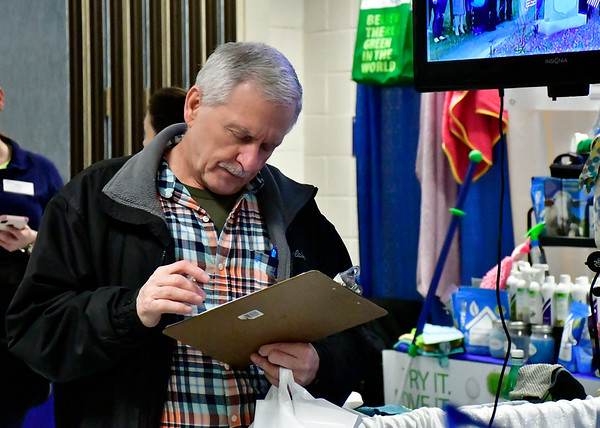 2/16/2019 Mike Orazzi | Staff Gary Martin fills out a survey for the Bristol Democrats during the 34th annual Bristol Home & Business Show at Bristol Eastern High School on Saturday.