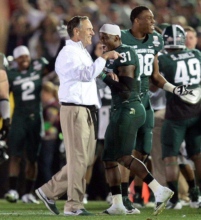 . Michigan State head coach Mark Dantonio and Darqueze Dennard #31 are all smiles as time expires during the 100th Rose Bowl game in Pasadena Wednesday, January 1, 2014. Michigan State defeated Stanford 24-20. (Photo by Hans Gutknecht/Los Angeles Daily News)