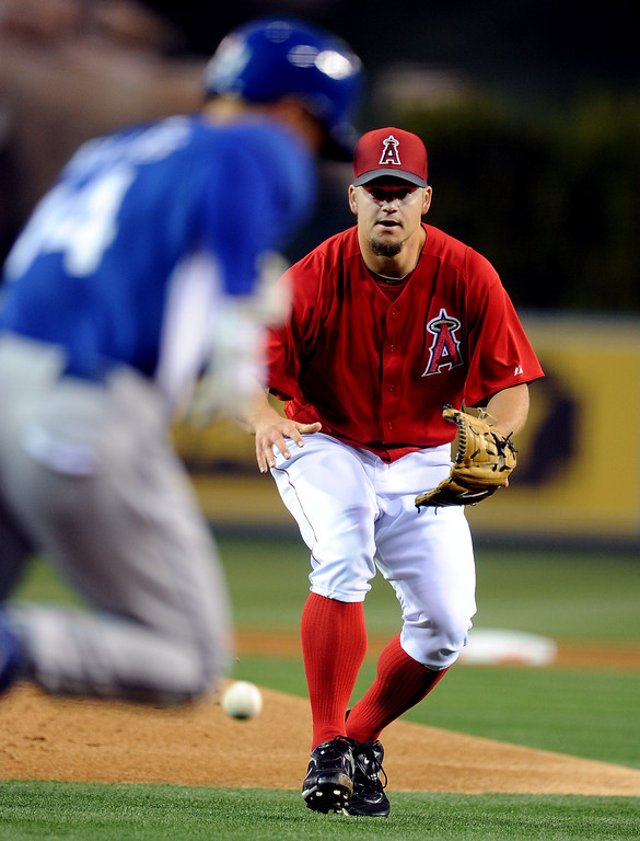 . Los Angeles Angels starting pitcher Joe Blanton makes the play on Los Angeles Dodgers\' Mark Ellis (14) in the first inning of a spring baseball game on Thursday, March 28, 2012 in Anaheim, Calif.   (Keith Birmingham/Pasadena Star-News)