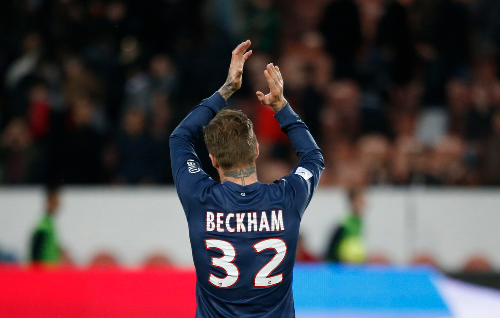 . Picture taken on March 9, 2013 shows Paris Saint-Germain\'s English midfielder David Beckham celebrating at the end of the French L1 football match Paris Saint-Germain vs Nancy at the Parc-des-Princes stadium in Paris. THOMAS COEX/AFP/Getty Images