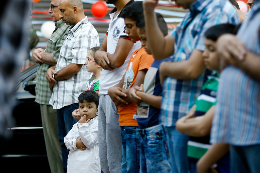. Lebanese men pray on the first day of Eid al-Adha in the southern port city of Sidon, Lebanon, Monday, Sept. 12, 2016. (AP Photo/Mohammed Zaatari)