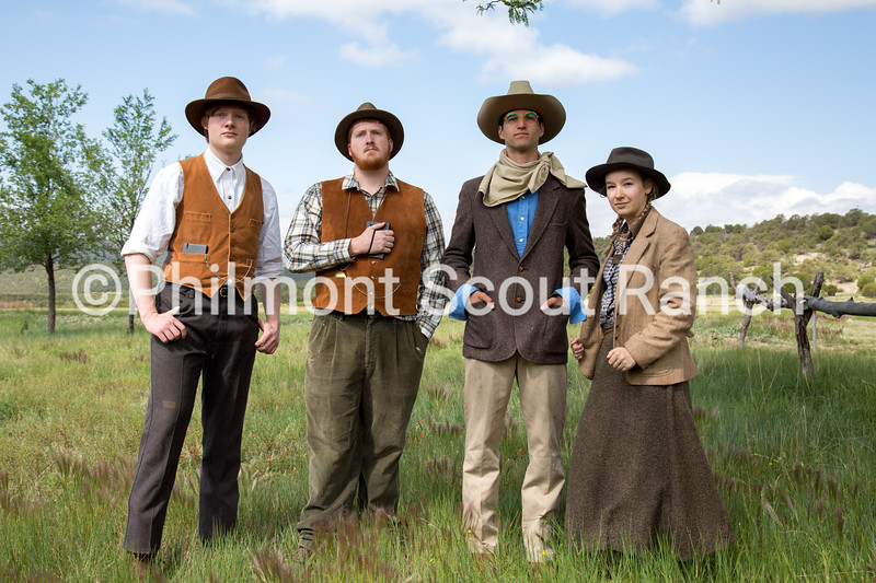 During living history training, staff members for Fish Camp, a historical re-enactment camp, pose for a photo. Fish Camp focuses on portaying the life of Waite Phillips and his family while offering activities like fly-tying and fishing.