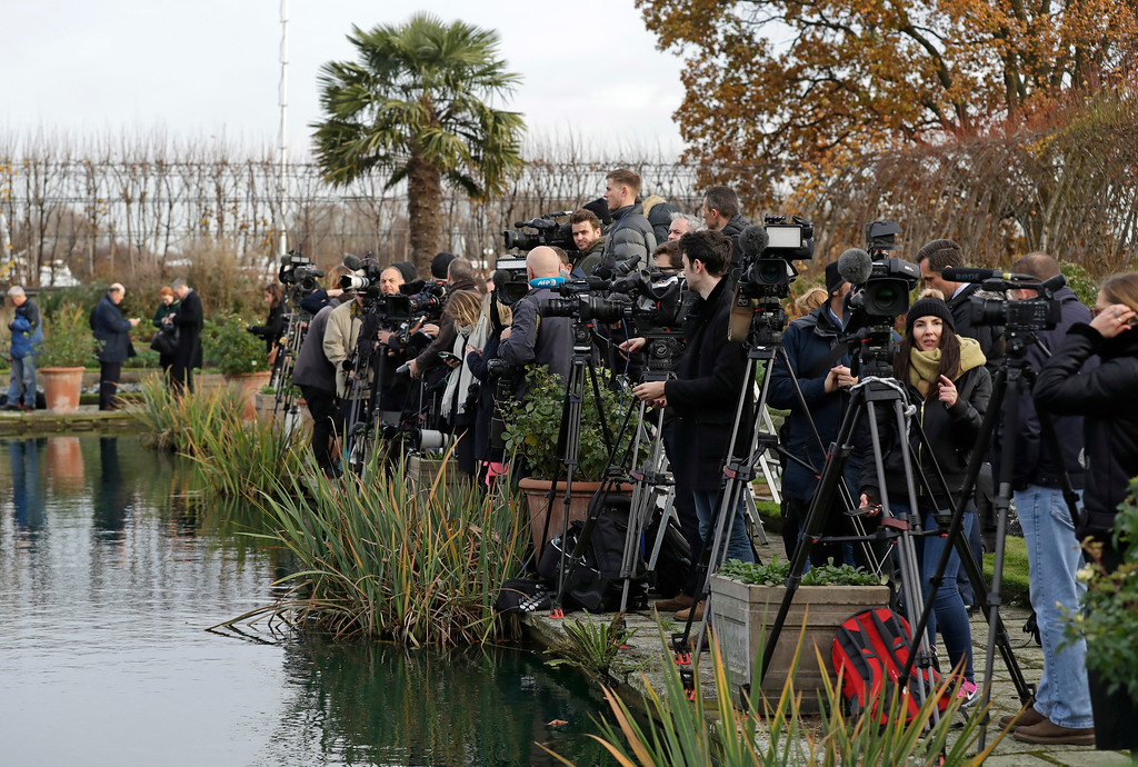 . Media wait for the arrival of Britain\'s Prince Harry and his fiancee Meghan Markle for a photocall in the grounds of Kensington Palace in London, Monday Nov. 27, 2017. Britain\'s royal palace says Prince Harry and actress Meghan Markle are engaged and will marry in the spring of 2018. (AP Photo/Matt Dunham)