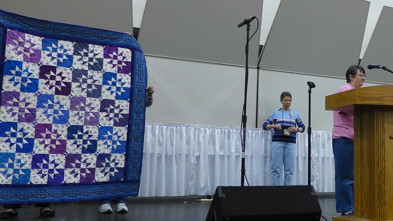 Jan Gagliano showing us a Disappearing Hourglass quilt.