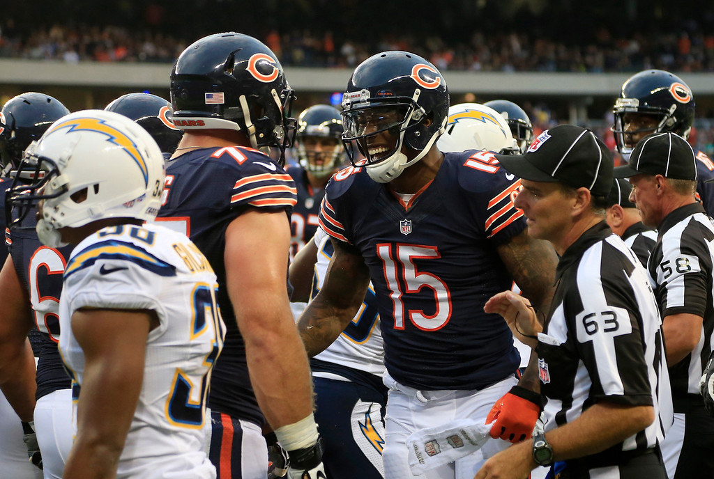 . Chicago Bears wide receiver Brandon Marshall (15) celebrates his touchdown reception against San Diego Chargers with his teammates during the first half of the preseason NFL football game, Thursday, Aug. 15, 2013, in Chicago. (AP Photo/Charles Rex Arbogast)