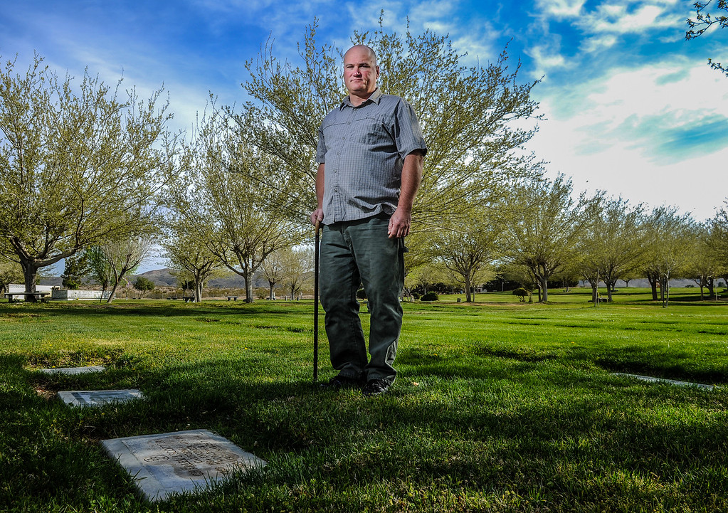 """. \""""Too many people from Hinkley are ending up here,\"""" 43-year-old resident Lester White said. White stands near his grandmother\'s gravestone at Mountain View Memorial in Barstow, Calif. on Monday, March 25, 2013. Many of White\'s family members, who live in Hinkley, have died of cancer and other diseases, and believes chromium 6 exposure is to blame for his family\'s health issues. (Rachel Luna / San Bernardino Sun)"""