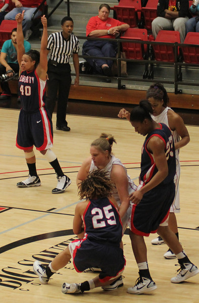 Breynna Winkler (43) gets a jump ball call after fighting for a rebound.