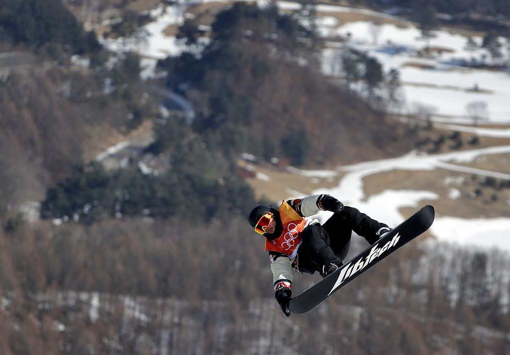 . Tyler Nicholson, of Canada, jumps during the men\'s slopestyle final at Phoenix Snow Park at the 2018 Winter Olympics in Pyeongchang, South Korea, Sunday, Feb. 11, 2018. (AP Photo/Gregory Bull)