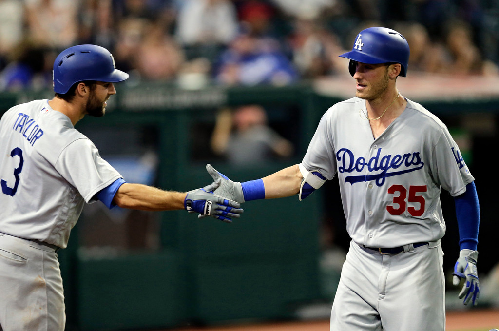 . Los Angeles Dodgers\' Cody Bellinger, right, is congratulated by Chris Taylor after Bellinger hit a solo home run off Cleveland Indians relief pitcher Andrew Miller in the eighth inning of an interleague baseball game, Tuesday, June 13, 2017, in Cleveland. (AP Photo/Tony Dejak)