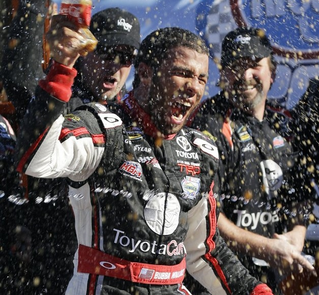 """. <p><b> Darrell Wallace Jr. made auto racing history on Saturday when he became the first African-American man to do this since 1963 � </b> <p> A. Win a NASCAR series race <p> B. Start on the pole in a NASCAR race <p> C. Attend a NASCAR race <p><b><a href=\'http://www.usatoday.com/story/sports/nascar/2013/10/26/darrell-wallace-jr-african-american-martinsville/3251393/\' target=\""""_blank\"""">HUH?</a></b> <p>   (AP Photo/Steve Helber)"""