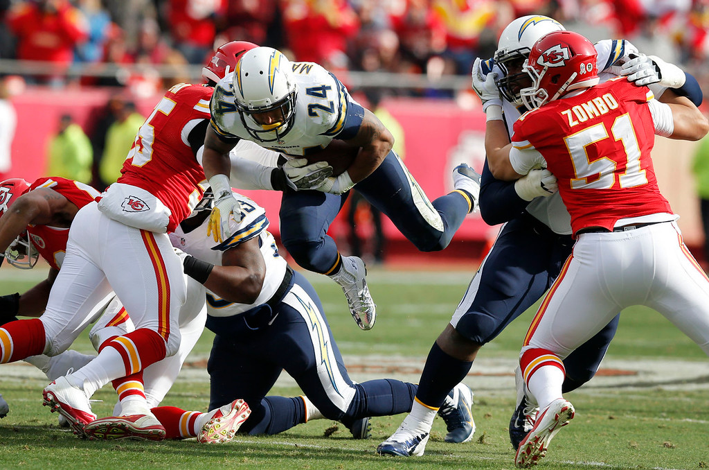. San Diego Chargers running back Ryan Mathews (24) dives for a first down between Kansas City Chiefs defenders during the first half of an NFL football game at Arrowhead Stadium in Kansas City, Mo., Sunday, Nov. 24, 2013. (AP Photo/Ed Zurga)