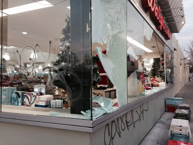 . Windows are shattered at the Walgreens store on Shattuck Avenue  and graffiti remains on the walls after a night of protest and violence in Berkeley, Calif., on Monday, Dec, 8, 2014. (Laura A. Oda/Bay Area News Group)