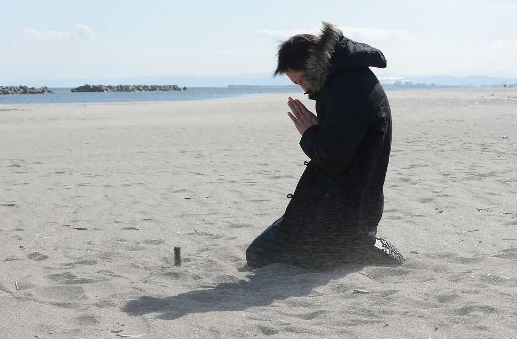 . Nobuhisa Iwai prays for his friend killed by the tsunami at Arahama district in Sendai, Miyagi Prefecture on March 11, 2013. Japan on March 11 marked the second anniversary of a ferocious tsunami that claimed nearly 19,000 lives and sparked the worst nuclear accident in a generation.  AFP PHOTO/Toru YAMANAKA/AFP/Getty Images