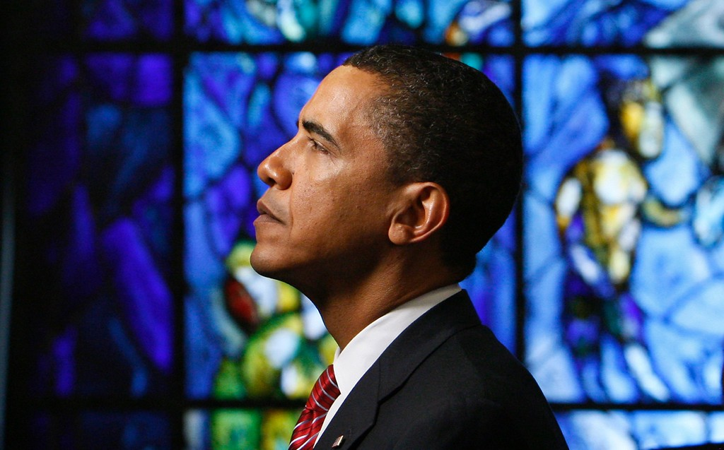 . With a backdrop of Chagall stained glass, President Barack Obama pauses after laying a wreath for United Nations staff members killed in the line of duty at the United Nations, Wednesday, Sept. 23, 2009. (AP Photo/Charles Dharapak)