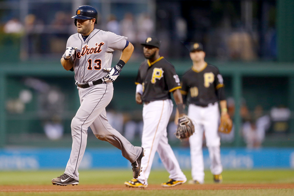 . Detroit Tigers\' Alex Avila (13) rounds the bases past Pittsburgh Pirates right fielder Josh Harrison, center, and shortstop Jordy Mercer after hitting a solo home run in the fourth inning of the baseball game on Tuesday, Aug. 12, 2014, in Pittsburgh. (AP Photo/Keith Srakocic)
