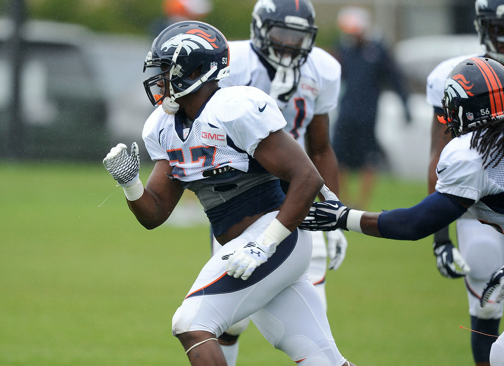 . Denver Broncos linebacker Steven Johnson (53) runs through drills on day seven of the Denver Broncos 2014 training camp July 31, 2014 at Dove Valley. (Photo by John Leyba/The Denver Post)