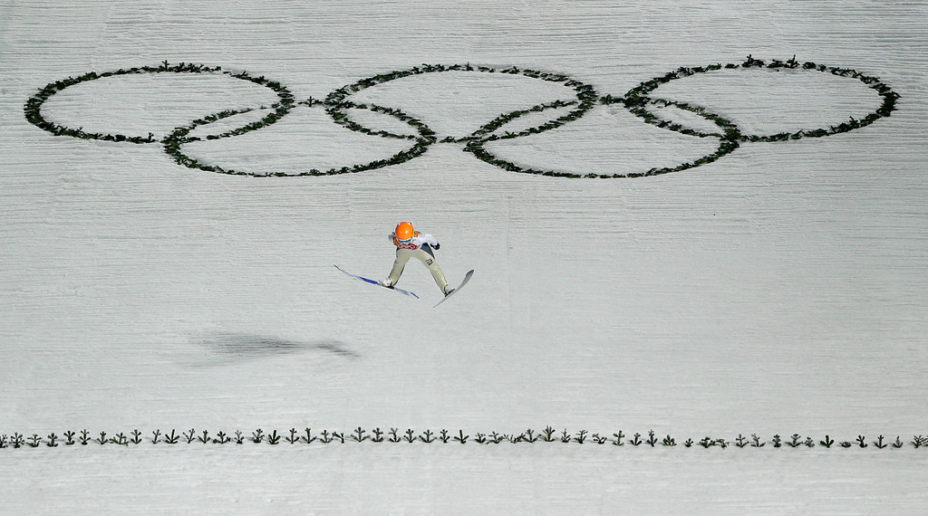 . Italy\'s Elena Runggaldier makes an attempt during the women\'s normal hill ski jumping final at the 2014 Winter Olympics, Tuesday, Feb. 11, 2014, in Krasnaya Polyana, Russia. (AP Photo/Matthias Schrader)
