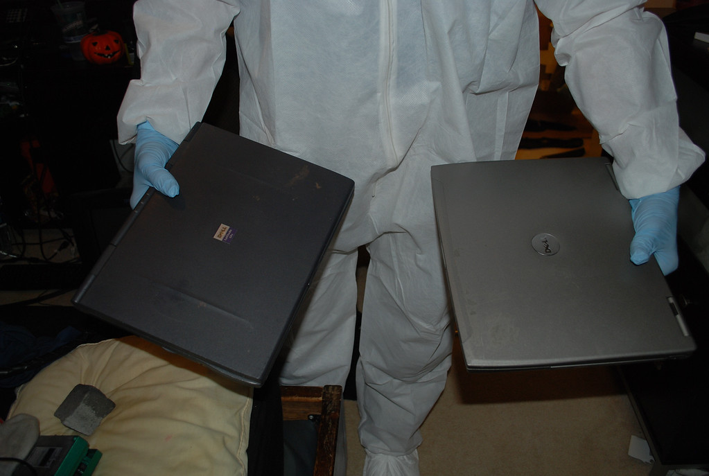 . An investigator holds up two laptop computers that were found in Austin Sigg\'s Westminster home. Sigg pleaded guilty to kidnapping and killing 10-year-old Jessica Ridgeway. Provided by Jefferson County District Attorney\'s Office