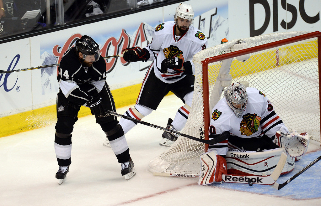 . Blackhawks goalie Corey Crawford makes the stop on a shot by the Kings� Justin Williams #14 during Game 6 of the Western Conference finals at the Staples Center on Friday, May 30, 2014. The Blackhawks beat the Kings 4-3. (Photo by Hans Gutknecht/Los Angeles Daily News)
