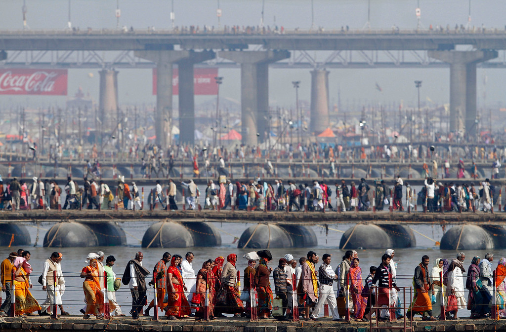 . Thousands of Indian Hindu devotees walk across pontoon bridges at Sangam, the confluence of the Rivers Ganges, Yamuna and mythical Saraswati on Maghi Purnima, or the full-moon day, considered an auspicious bathing day, during the Maha Kumbh festival in Allahabad, India, Monday, Feb. 25, 2013. Millions of Hindu pilgrims have been attending the Maha Kumbh festival, which is one of the world\'s largest religious gatherings that lasts 55 days and falls every 12 years. (AP Photo/Rajesh Kumar Singh)