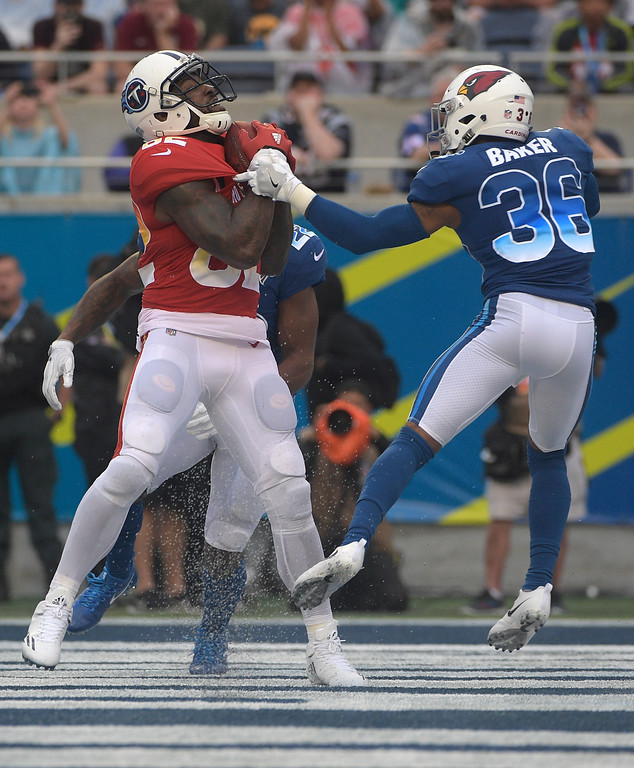 . AFC tight end Delanie Walker (82), of the Tennessee Titans grabs a touchdown pass over NFC safety Budda Baker (36), of the Arizona Cardinals, during the second half of the NFL Pro Bowl football game, Sunday, Jan. 28, 2018, in Orlando, Fla. (AP Photo/Phelan M Ebenhack)