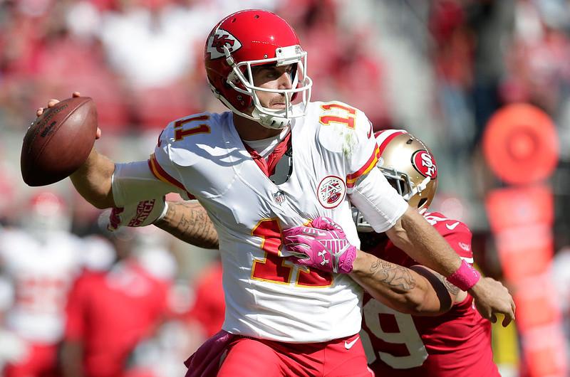. Kansas City Chiefs quarterback Alex Smith (11) is pressured by San Francisco 49ers linebacker Aaron Lynch during the second quarter of an NFL football game in Santa Clara, Calif., Sunday, Oct. 5, 2014. (AP Photo/Marcio Jose Sanchez)