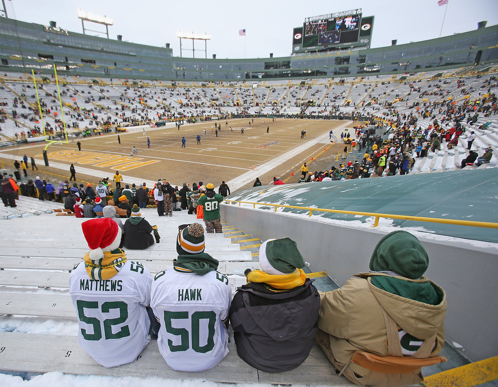 . Fans of the Green Bay Packers watch a game on the view screen as players come out for warm-ups before a game between the Packers and the Pittsburgh Steelers at Lambeau Field on December 22, 2013 in Green Bay, Wisconsin.  (Photo by Jonathan Daniel/Getty Images)
