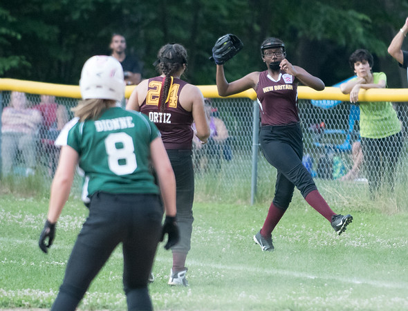 07/02/18 Wesley Bunnell | Staff New Britain vs Bristol district 5 softball tournament game at Rockwell Park on Monday evening. Leah Dionne (8) watches as New Britain's right fielder Jenaya Evelyn (13) makes a tough running catch down the line.