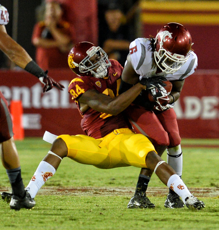. Washington State\'s Damante Horton #6 intercepts a pass intended for USC\'s Darreus Rogers #84 in the 4th quarter during their game at the Los Angeles Memorial Coliseum  Saturday, September 7, 2013. Washington State beat USC10-7. (Photo by Hans Gutknecht/Los Angeles Daily News)