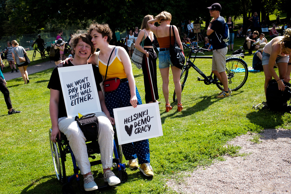 . A couple arrive for a rally against the policy of U.S. President Donald Trump and Russian President Vladimir Putin in Helsinki, Sunday, July 15, 2018. President Trump and President Putin will meet in Finland\'s capital on Monday, July 16, 2018. (AP Photo/Markus Schreiber)