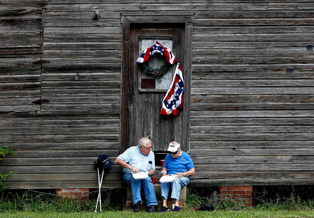 . Robert and Gena Phillips eat fried fish, coleslaw and hushpuppies following the annual Independence Day parade on Thursday, July 4, 2013 in Micanopy, Fla. (AP Photo/The Gainesville Sun, Matt Stamey)
