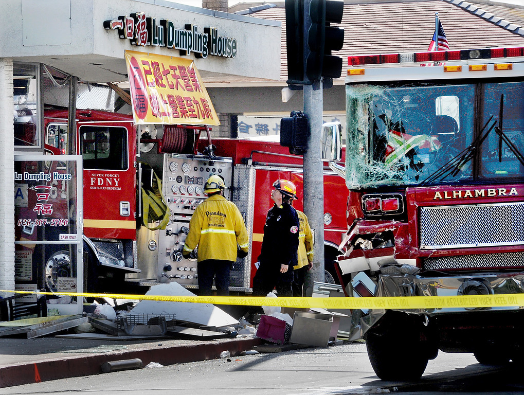 . An Alhambra Fire ladder truck and Monterey Park Fire truck collided in the intersection of Garfield Avenue and Emerson Avenue Wednesday April 16 2014. The Monterey Park Fire engine drove into a Chinese restaurant. One civilian is in critical condition,  one firefighter with moderate injuries, and five firefighters with minor injuries, and  eight civilians with minor injuries.(Photo by Walt Mancini/Pasadena Star-News)