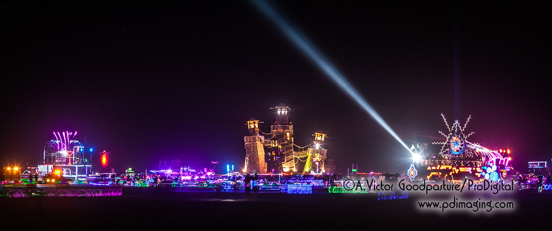 Black Rock Lighthouse is straddled by two EDM art cars.
