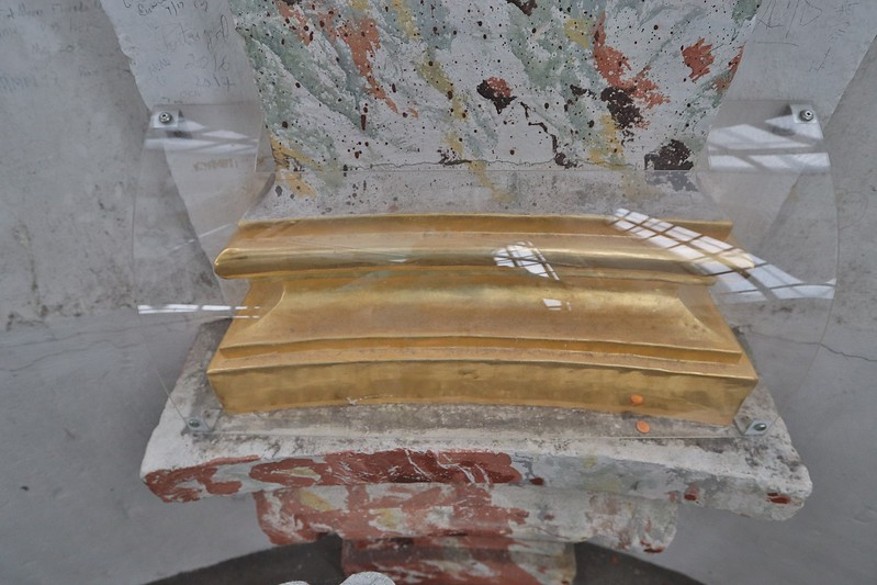 Gold leaf is temporarily protected from visitors who normally would be far below.