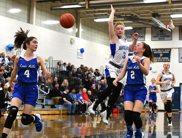 2/13/2020 Mike Orazzi | Staff Lewis Mills' Lauren Alvarez (4) and Abby Mills (2) with Bristol Eastern's Jessica Levesque (3) during Thursday night's girls basketball game in Bristol.
