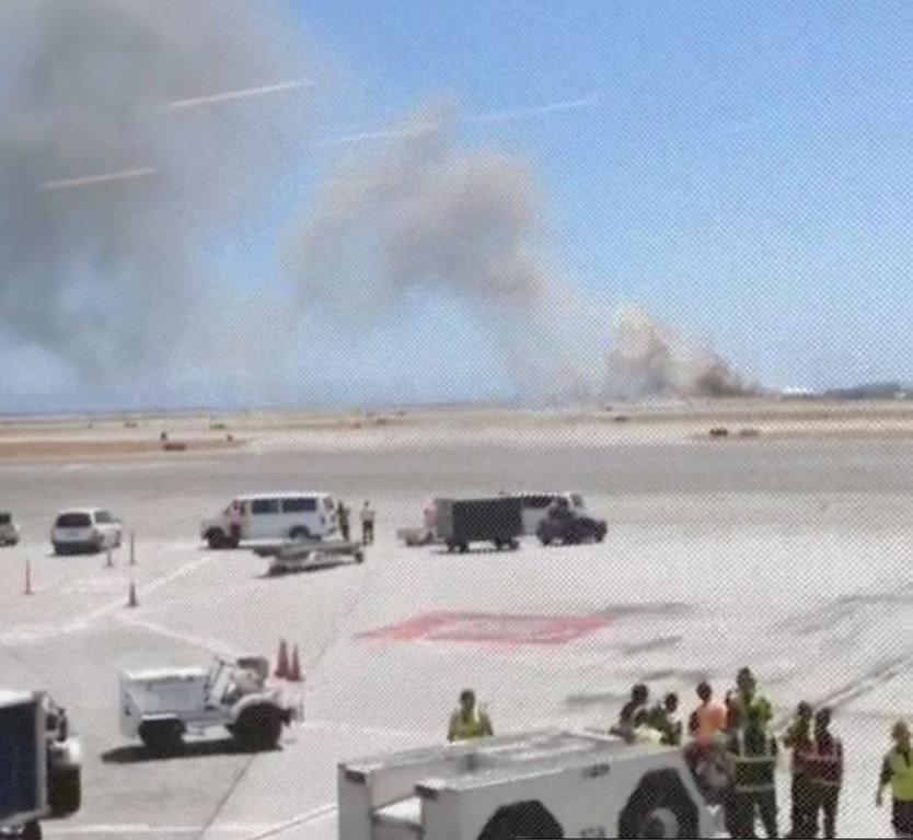. This photo provided by Wei Yeh shows what a federal aviation official says was an Asiana Airlines flight crashing while landing at San Francisco airport on Saturday, July 6, 2013. It was not immediately known whether there were any injuries. (AP Photo/Wei Yeh)