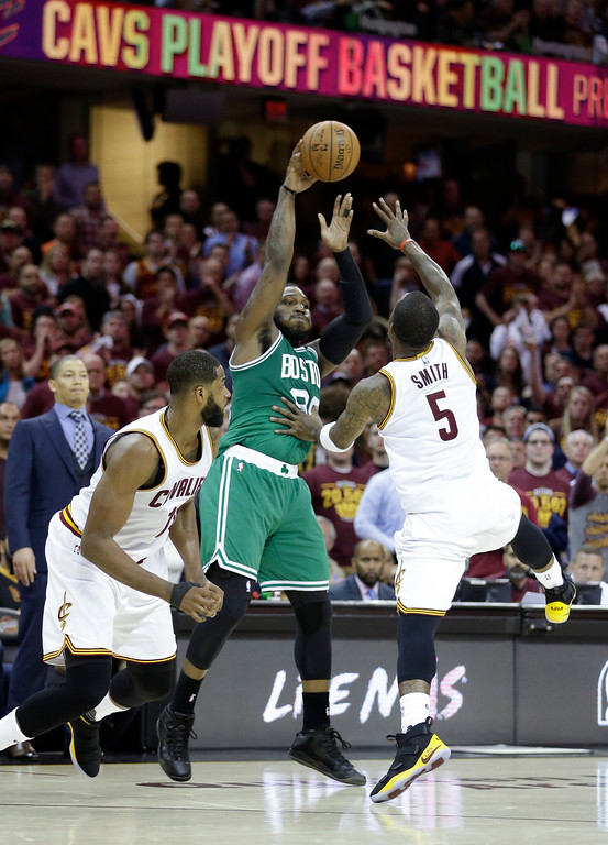 . Boston Celtics\' Jae Crowder (99) passes against Cleveland Cavaliers\' J.R. Smith (5) and Tristan Thompson during the first half of Game 4 of the NBA basketball Eastern Conference finals, Tuesday, May 23, 2017, in Cleveland. (AP Photo/Tony Dejak)