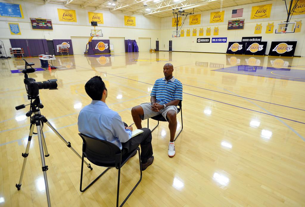 . LANG reporter Mark Medina talks with Lakers head coach Byron Scott talks about the upcoming NBA season at the Lakers training faciltiy in El Segundo, CA on Tuesday, September 9, 2014. (Photo by Scott Varley, Daily Breeze)