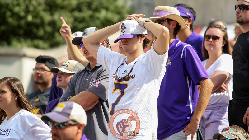 An ECU fan cannot bear to watch as his team goes down big in the second half. (Mark Umansky/TheKeyPlay.com)