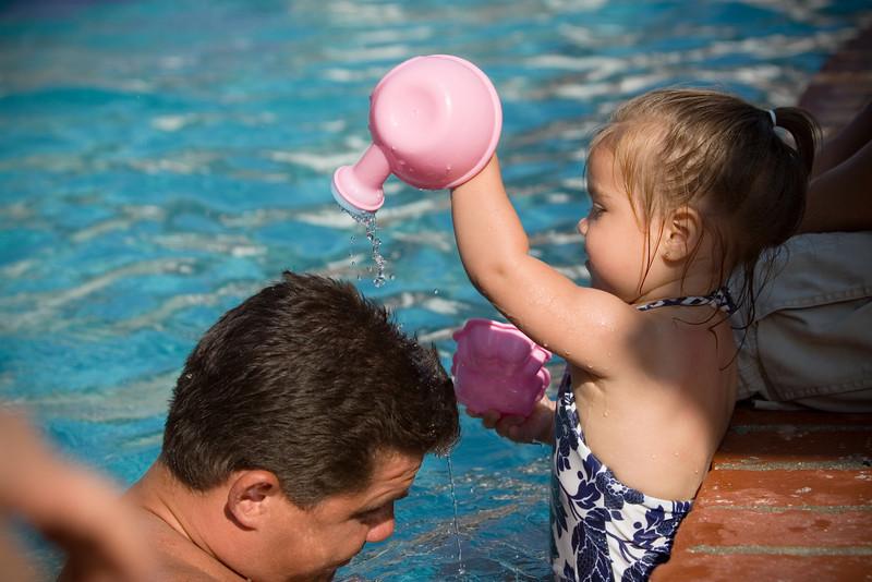 Ah...she is watering her dad's hair