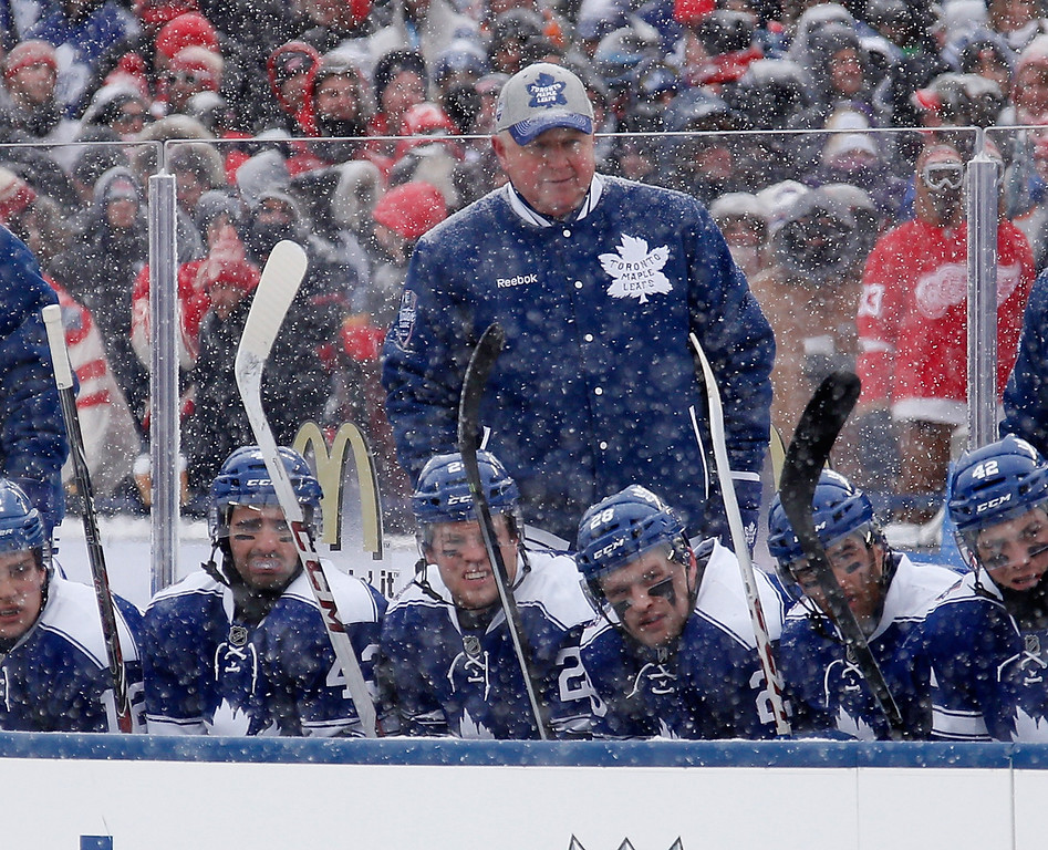. Head coach Randy Carlyle of the Toronto Maple Leafs watches the action against the Detroit Red Wings in the first period of the 2014 Bridgestone NHL Winter Classic at Michigan Stadium on January 1, 2014 in Ann Arbor, Michigan. (Photo by Gregory Shamus/Getty Images)
