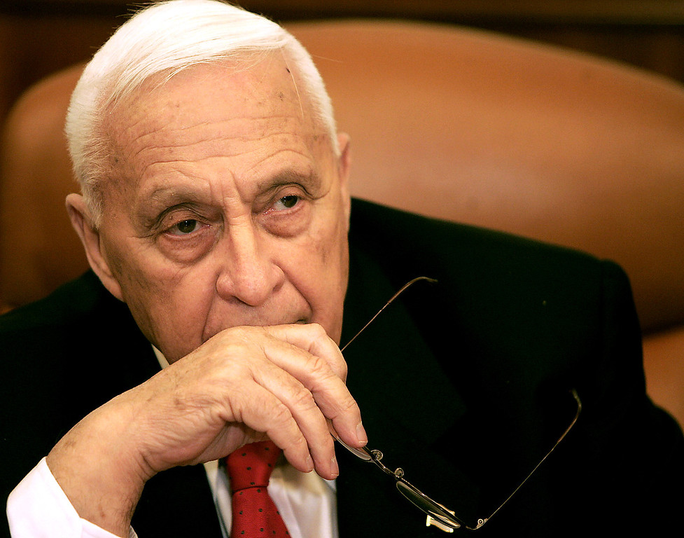 . Israeli Prime Minister Ariel Sharon looks on during a ceremony completing the sale of Bank Leumi to a private U.S. investment group in his office on January 4, 2006 in Jerusalem, Israel.  (Photo by Eliana Aponte-Pool/Getty Images)
