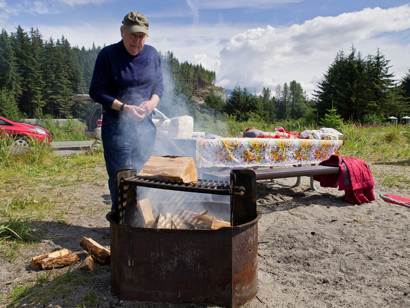 Pat looking kind of strange as he starts the fire and then cooks a raw burger for himself at our recent Eagle beach picnic.