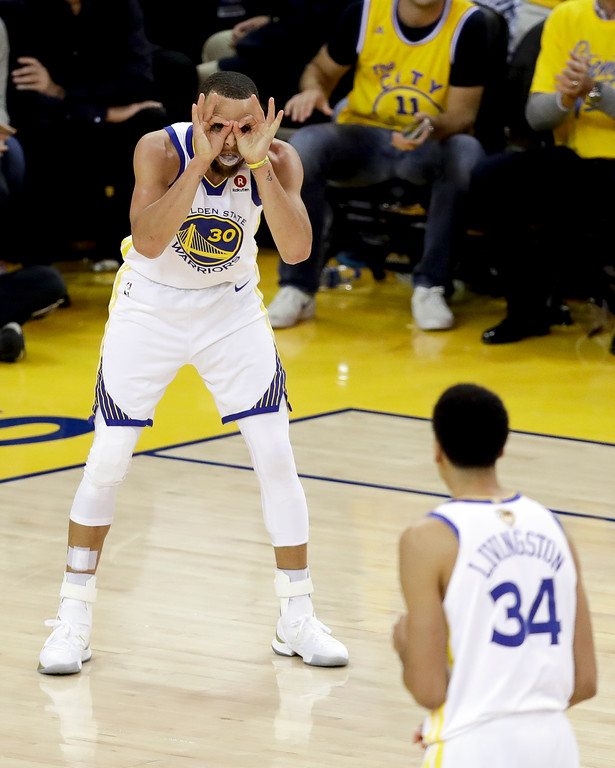 . Golden State Warriors guard Stephen Curry (30) celebrates during overtime of Game 1 of basketball\'s NBA Finals between the Warriors and the Cleveland Cavaliers in Oakland, Calif., Thursday, May 31, 2018. (AP Photo/Marcio Jose Sanchez)