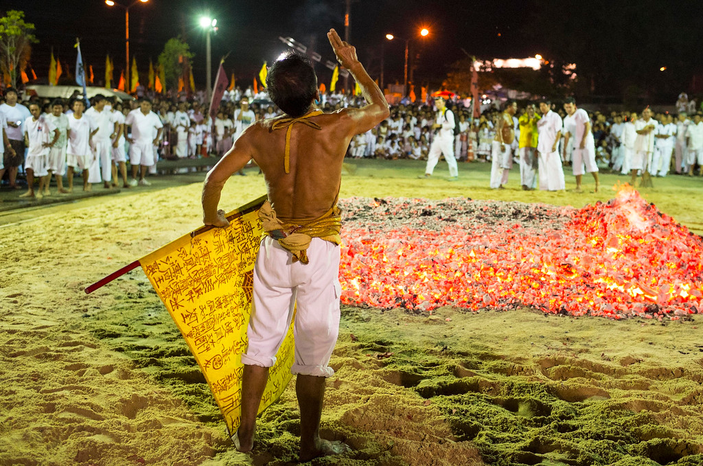 . A devotee calls out to the Gods prior to walking across hot coals outside Ban Tha Rue Shrine during fire walking ceremonies  on September 29, 2014 in Phuket, Thailand.  (Photo by David Longstreath/Getty Images)